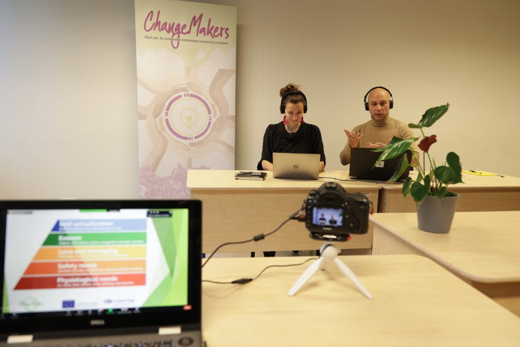 Two people talking at a video conference with laptops.